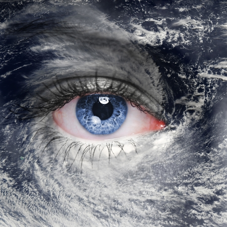A blue eye in the middle of a tropical hurricane. Elements of this image furnished by NASA Imagens
