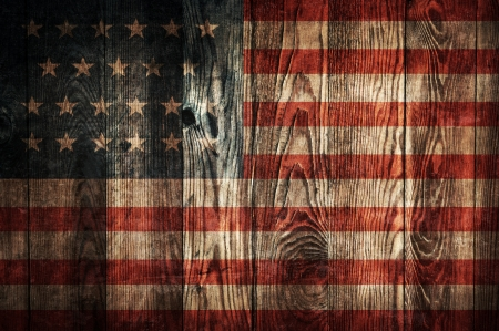 Dark wooden plank wall background with flag of USA