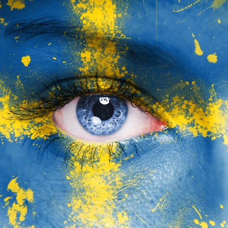 Sweden flag painted on woman face photo