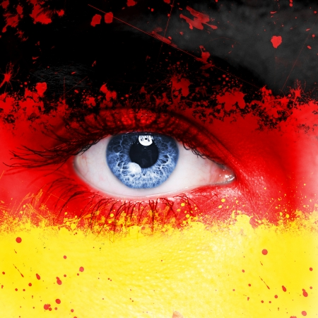 Germany flag painted on woman face photo