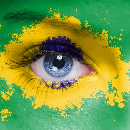 Brazil flag painted on woman face