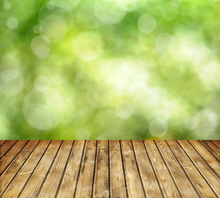 Empty wooden table and spring defocused background