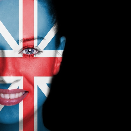 Woman face covered with flag of Great Britain photo