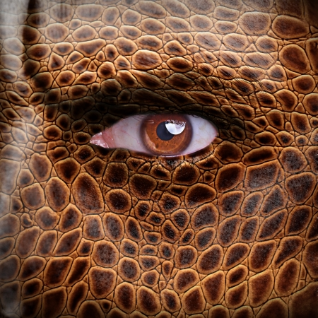 man face: Lizard skin pattern on angry man face - nature concept Stock Photo