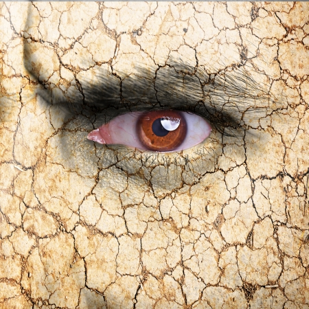 beautiful angry: Nature concept - man face covered with cracked earth texture - symbol of dry skin