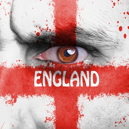 England flag painted on angry man face photo