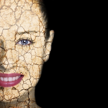 broken up: Beauty concept - woman face covered with cracked surface - symbol of dry skin