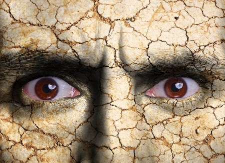 dryness: Beauty concept - face covered with cracked surface - symbol of dry skin