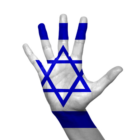 Israel flag painted on hand over white background photo