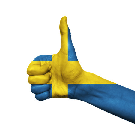 Sweden flag painted on hand over white background photo