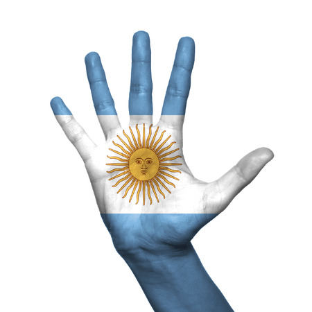 Argentina flag painted on hand over white background photo