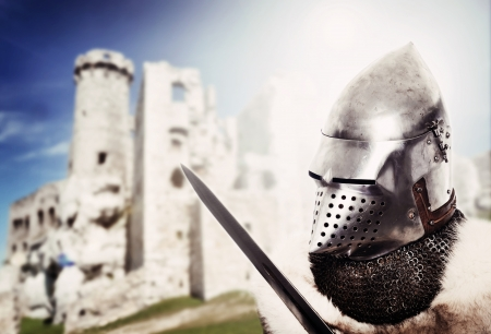 Portrait of XV century knight over castle background photo