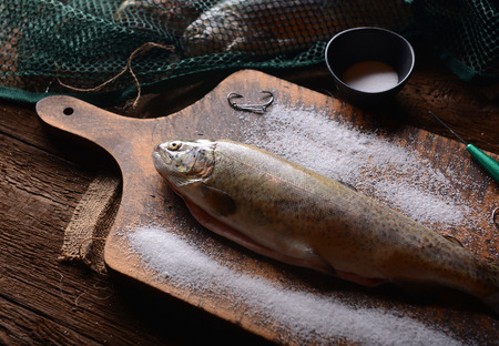 fish rearing: Fresh trouts on wooden background Stock Photo