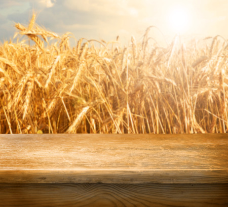 wheat flour: Empty table and defocused wheat field inbackground Stock Photo