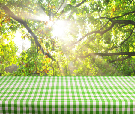 Empty table and defocused forest dawn inbackground