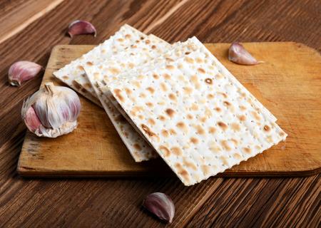 matzo: passover bread with garlic on wooden background