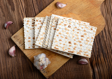 matzos: passover bread with garlic on wooden background