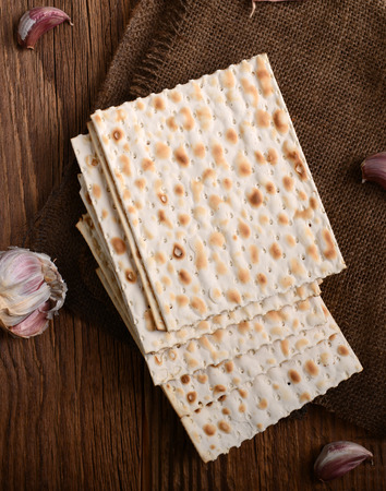 pesakh: passover bread with garlic on wooden background