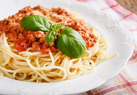 Tasty spaghetti with cheese and basil Stock Photo