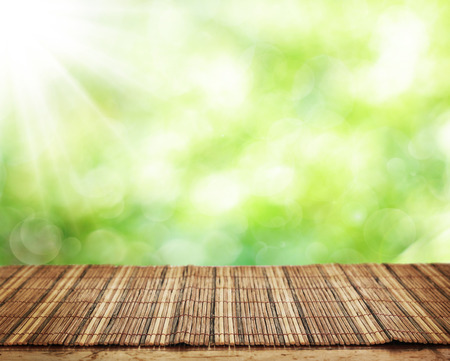 thailand bamboo: Empty table and defocused fresh green background