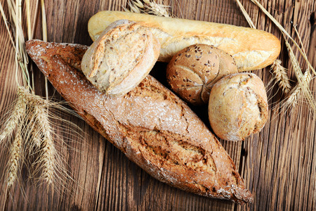 bakery oven: Fresh bread on wooden background