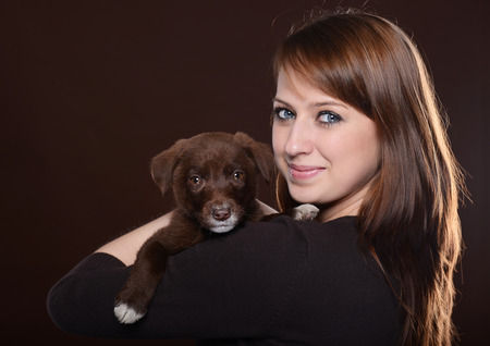 woman with dog on brown background photo