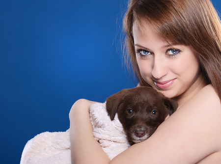Beautiful girl with young dog photo