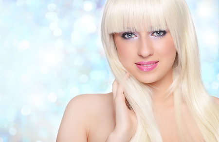 Beautiful blonde over blue background photo