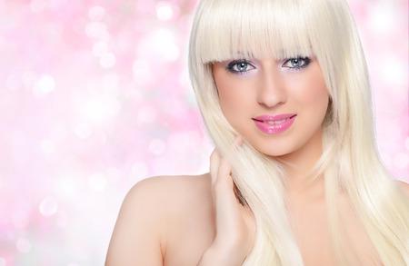 Beautiful blonde over white background photo