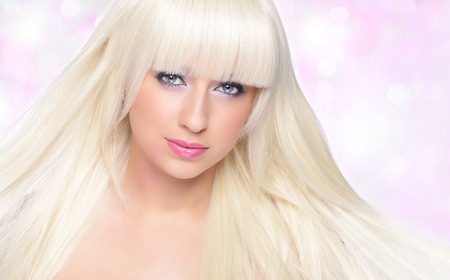Beautiful blonde over pink background photo