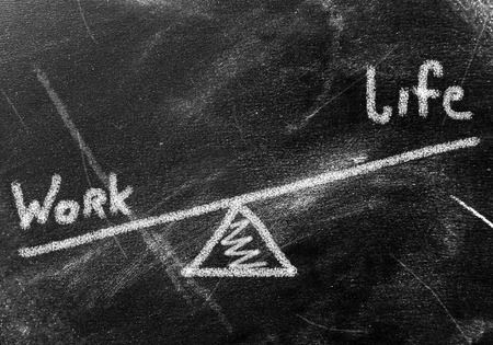 business concept - work and life on blackboard photo