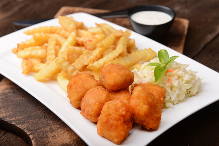 Fries with chicken nuggets and salad photo
