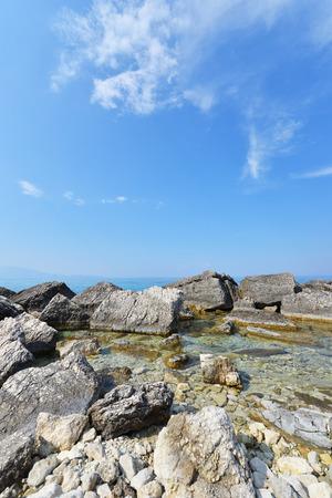 Blue water and rocks - Greece islands coastline photo