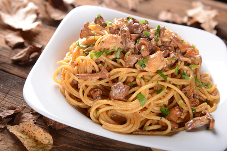 Pasta with chanterelles mushrooms and chicken photo