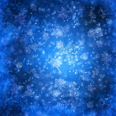 Blue christmas background with snowflakes Imagens