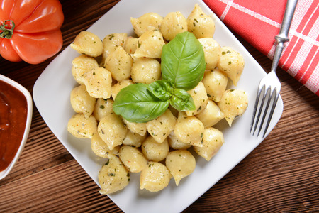 Gnocchi with cheese and tomatoes photo