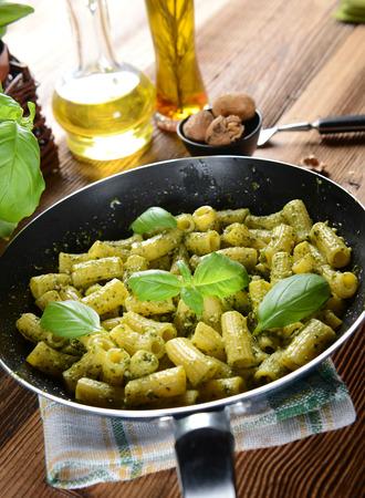 Italian pasta with green basil pesto photo