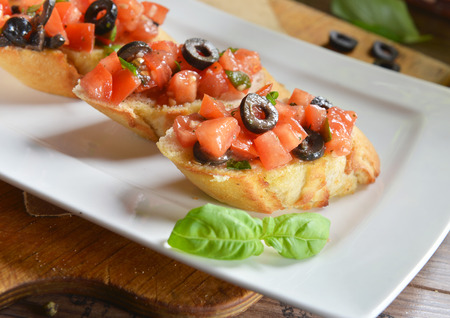bruschetta with tomatoes, olives and basil