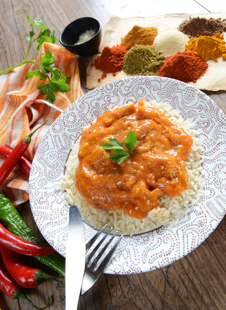 garam: Traditional india meal - rice tikka masala with chicken