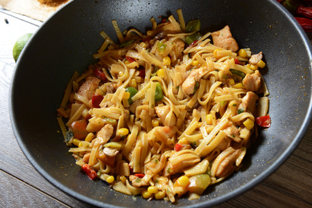 mie noodles: Traditional indonesian meal bami goreng with noodles, vegetables and chicken