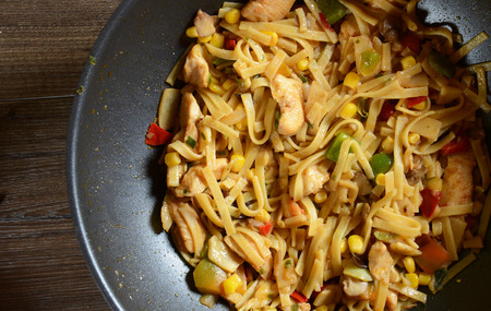 Traditional indonesian meal bami goreng with noodles, vegetables and chicken photo