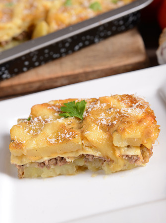 Casserole with potatoes, cheese and meat photo
