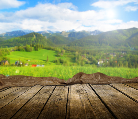 Empty wooden deck table with summer background. Ready for product display montage. Stockfoto