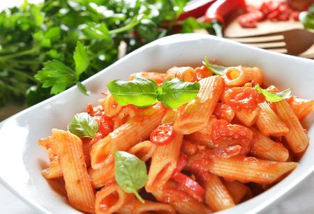 Penne pasta with chili sauce arrabiata photo