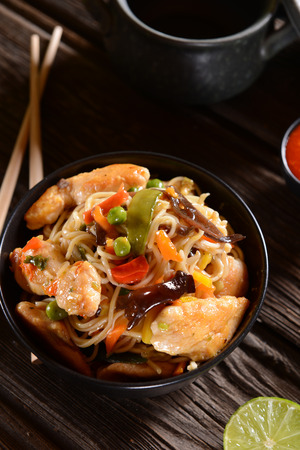 china cuisine: Chicken with Rice Noodles and Vegetables Stock Photo