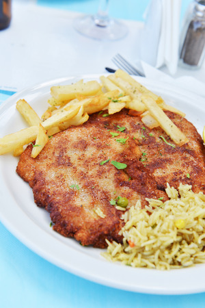 chops: Fried pork chops with fries Stock Photo