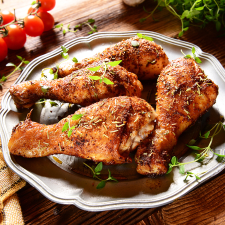 roasted chicken: Roasted chicken legs with thyme Stock Photo