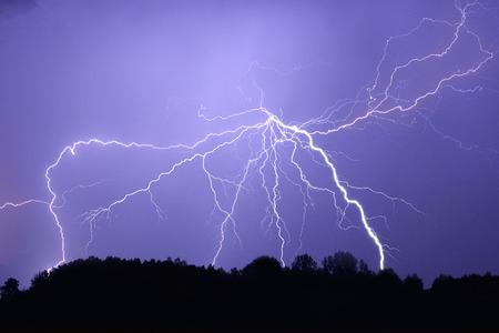 forked: Lightning bolt at night Stock Photo
