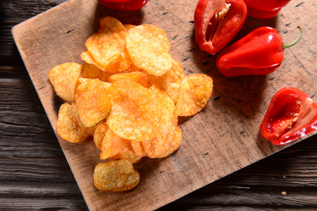 potato chip: Paprika Potato Chips on rustic background Stock Photo