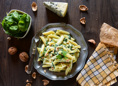 Penne pasta with gorgonzola sauce and spinach